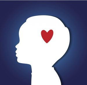 white profile of a child with a red heart over the head