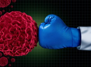boxing glove punching a cancer virus