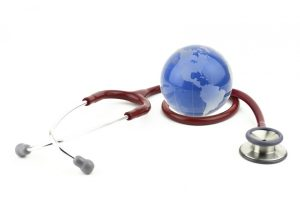 Photo of a small globe sitting by a stethoscope
