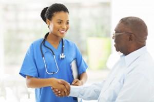 A nurse shakes a patient's hand