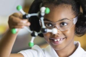 girl examines a molecule