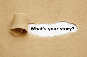 "A piece of paper peeled back that reveals the phrase ""What's Your Story?"""