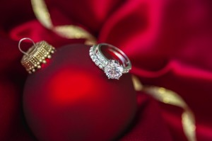 engagement rings on top of a holiday decorative bulb
