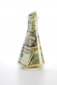 money stuffed in a beaker