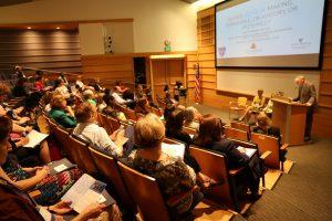 crowd gathered in Albert H. Owens Jr. Auditorium listens to a presentation