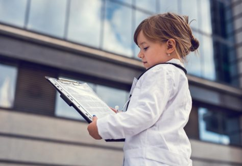 little girl in medical lab coat