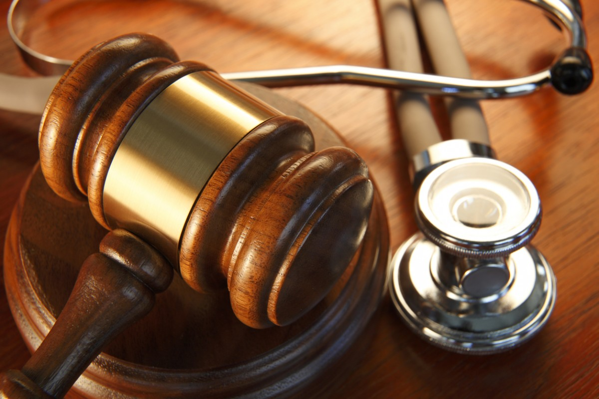 a gavel next to a stethescopte