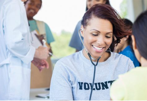 nurse volunteer takes a patient's vitals