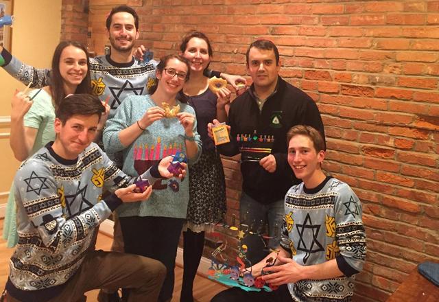 a group of friends celebrating Hanukkah