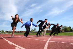 business people running on a track