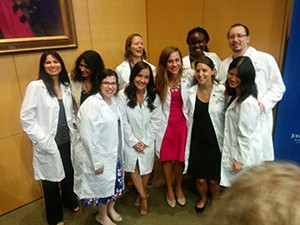 Joelle Dorskind and her colleagues in white lab coats