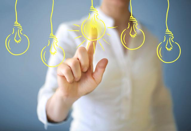 woman selecting light bulbs