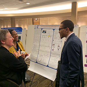 students talking about poster