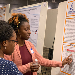 poster presentation with two students