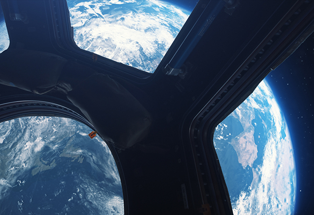 A view of Earth from space, as seen from a window of the International Space Station.