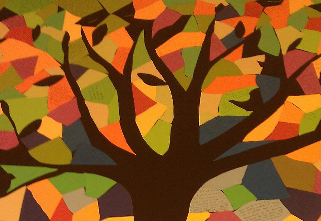 A mosaic of colorful papers, forming the image of a tree, made by Pranoti and her classmates.