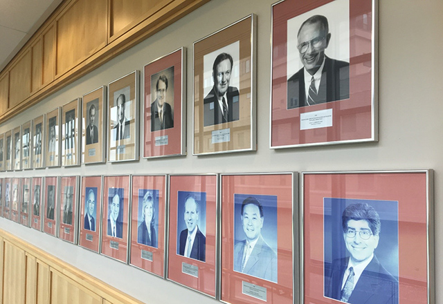 A wall of male portraits.