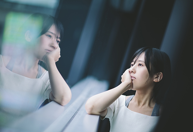 Woman thinking deeply by the window.
