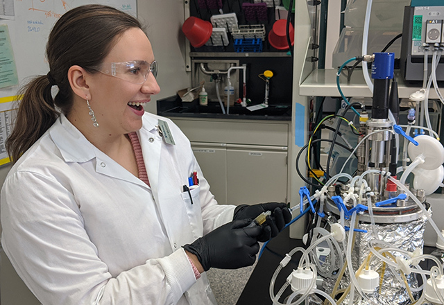 Natalie Majewska smiles while working in the lab.