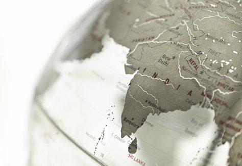 A close-up on India on a plexiglass globe.