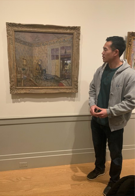 Medical student looking at art in the museum.