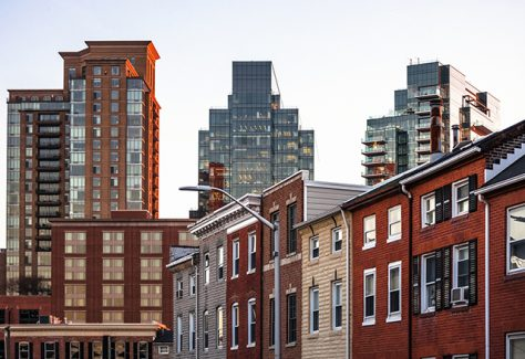 A skyline of Baltimore rowhomes and office buildings.