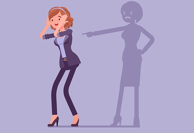 A cartoon illustration of a stressed woman cowering from her own foreboding shadow, in a representation of self-blame.