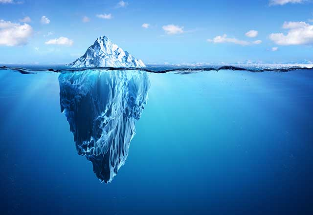 Image showing the tip of an iceberg above the water.