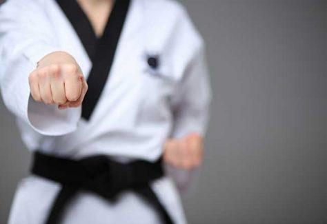 Person punching forward while practicing taekwondo