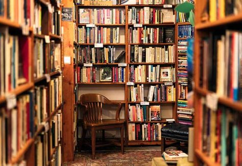 Interior of a bookstore with floor to ceiling bookshelves