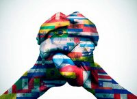 Latin American flags superimposed onto clasped hands.