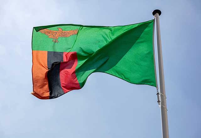 Zambia flag waving in the wind.
